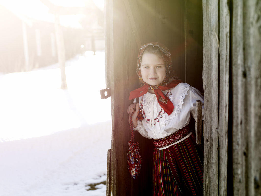 Estonian girl dressed in a traditional dress in Audru