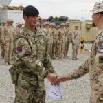 Estonian soldier greeting a British soldier in Afghanistan