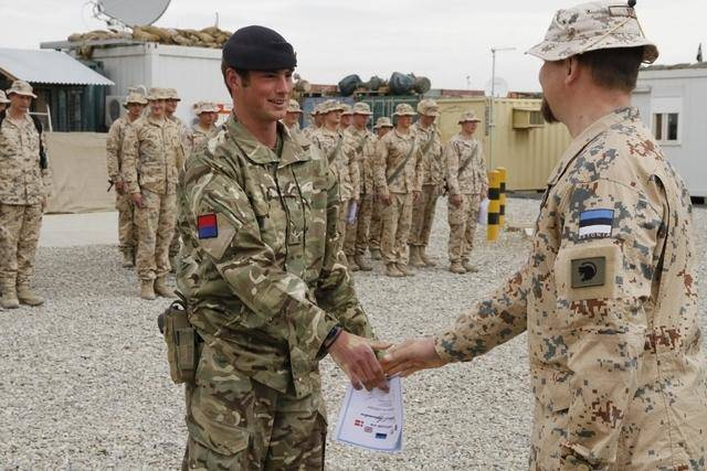 Estonian soldier greeting a British soldier in Afghanistan.