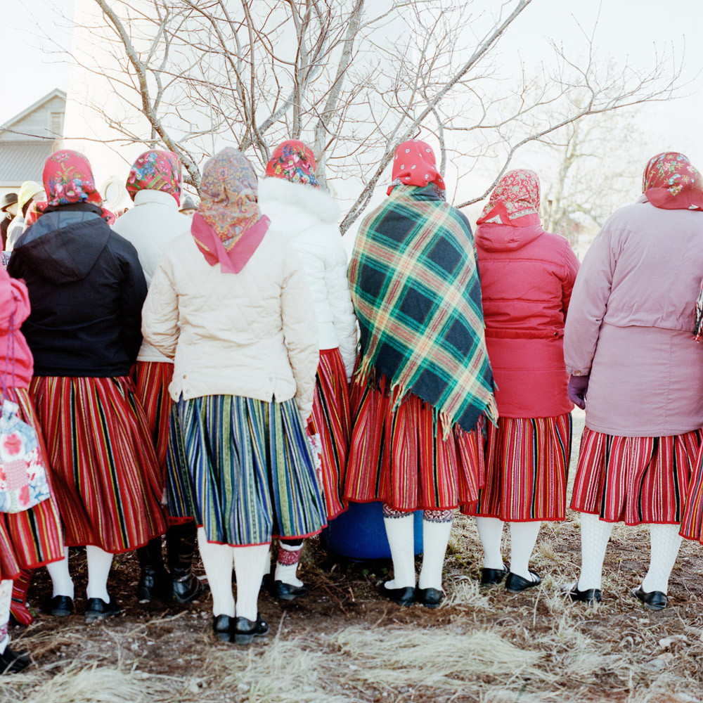 Celebration for the re-opening to the public of Kihnu lighthouse. The woman's skirt colour is meaningful. In times of mourning, it will turn black, the mourning fading away, blue will be re-introduced then the bright red will be back. A skirt keeping its owner history, a young girls usually wear a much more vivid skirt than an older woman. Kihnu an Estonian island located in the Riga gulf is listed as World Intangible Heritage of Humanity by the UNESCO for the unique expression of its culture through its folklore (music, clothing, customs). Kihnu, Estonia, 30 April 2013.