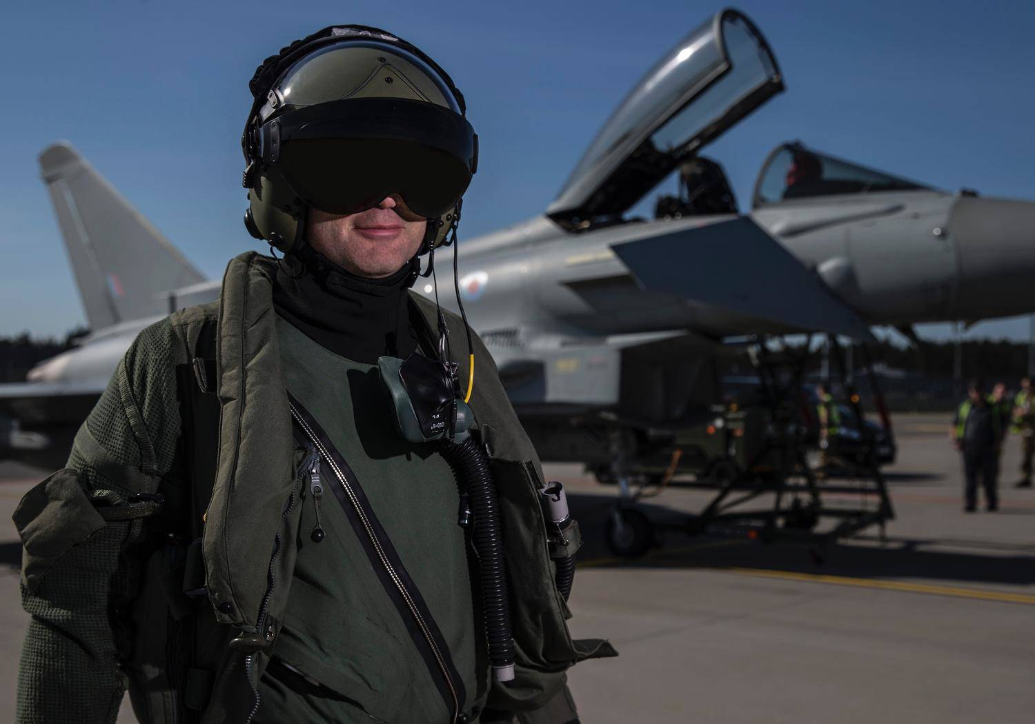 A UK fighter pilot posing with his Typhoon fighter. Photo: UK Ministry of Defence