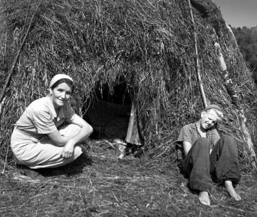Lee-Ella Kuusik together with her son Tiit (born in 1939) during haymaking in the Borovskoi collective farm, 1952.