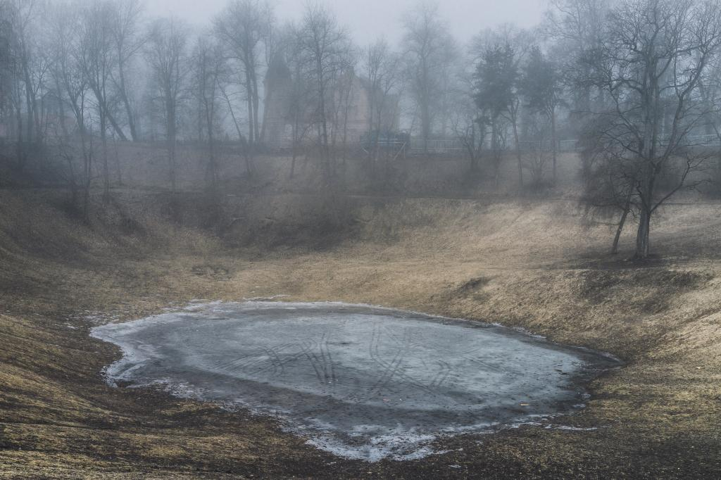Kassitoome, Tartu. Just around the corner from my home street there's a park with a man-made crater in the middle of it. Kids come here sledging until it turns into a lake and then a lawn in the spring. Or maybe they are gone because, aliens. The place looks like a landing site.