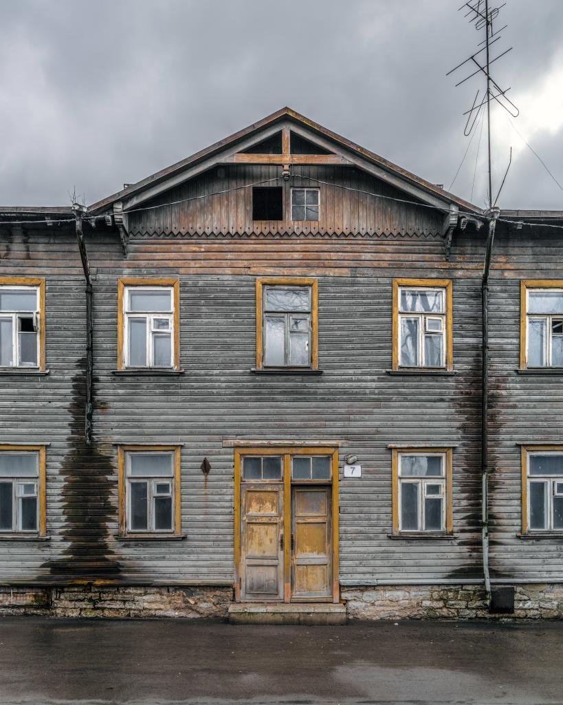 Kalamaja, Tallinn. Some houses really aren't built for the looks. They are so forgettable that even their owners don't seem to notice them — failing to take care of the drainpipes, boards and doors. But in the end all this forgetting finally turns them into pieces of art. This house is like mist, but with yellow window frames.