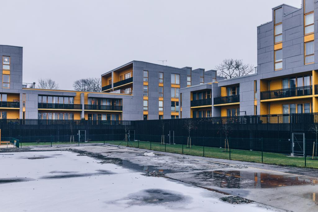 Kalamäe, Tallinn. We've learned to design and construct decent houses in Estonia, but the landscape architecture is still lagging behind. The spaces around and between houses are not built for humans. They are either for parking cars or just an amorphous, purposeless zone of random fences and lifeless low-trimmed lawn. The only way to spot the difference between some residential developments and prison architecture is by the height of the fences.