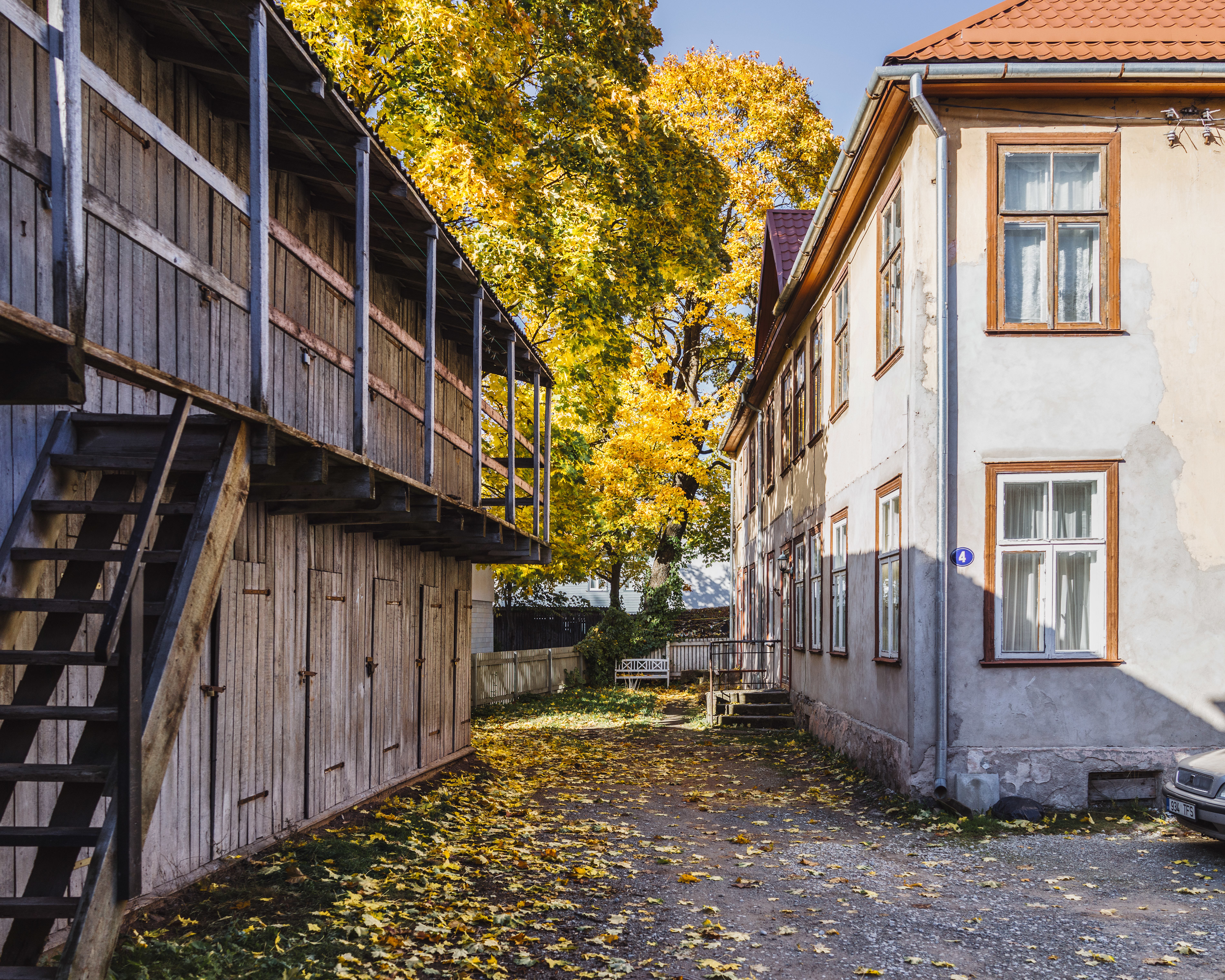 """Karlova, Tartu. I wandered into this courtyard and complimented the locals for the beauty of it. Their tired response: """"Yeah, right, it will be November in no time"""" –alluding that this all is just deceptive pre-rot. Yes –all those leaves are beautiful only until it's not your responsibility to clean this mess up after the show."""