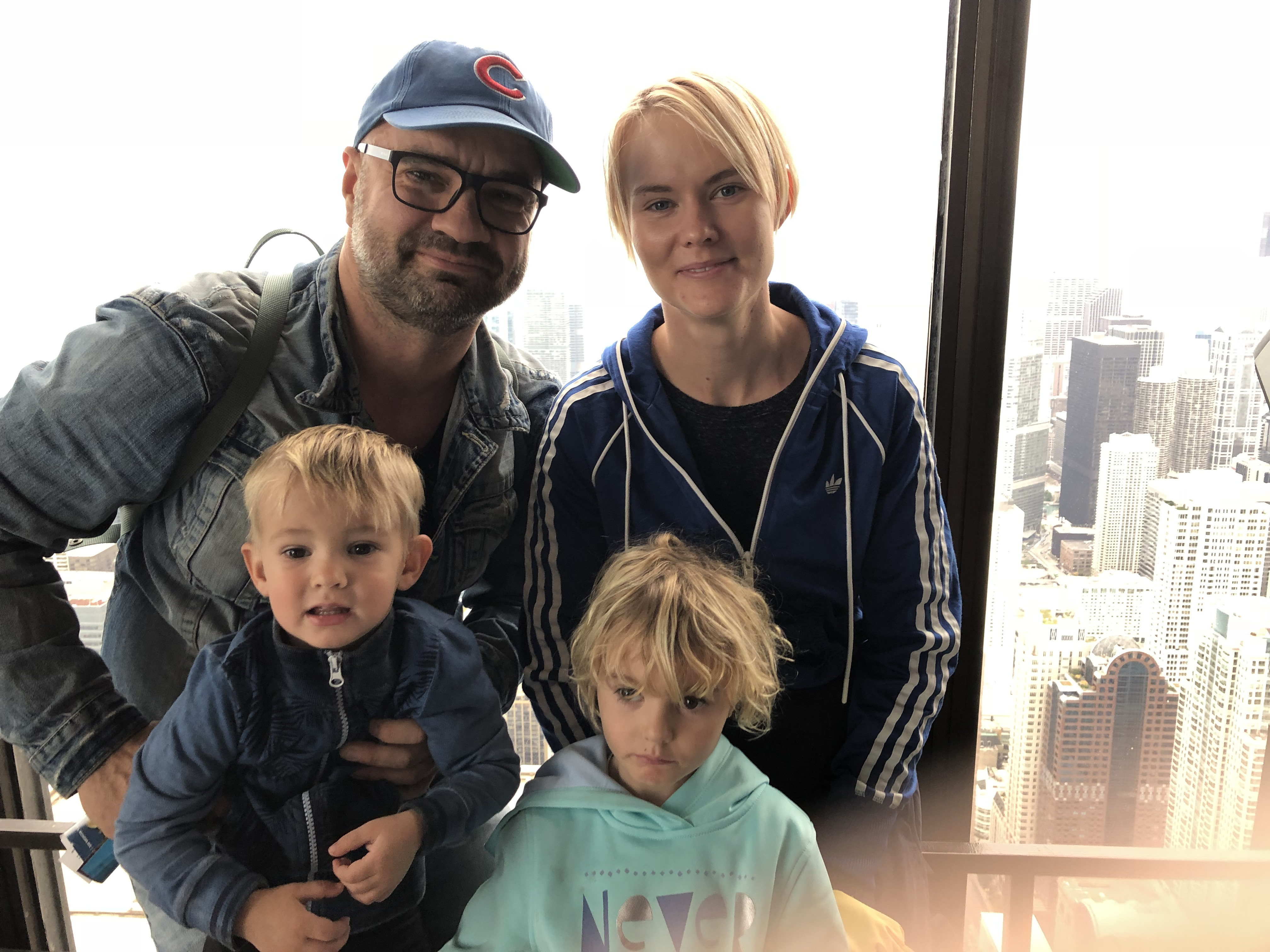 Mihkel and his family: wife Liina, daughter Mirjam and son Joosep, at the observation deck of one of the highest buildings in Chicago, the John Hancock tower.