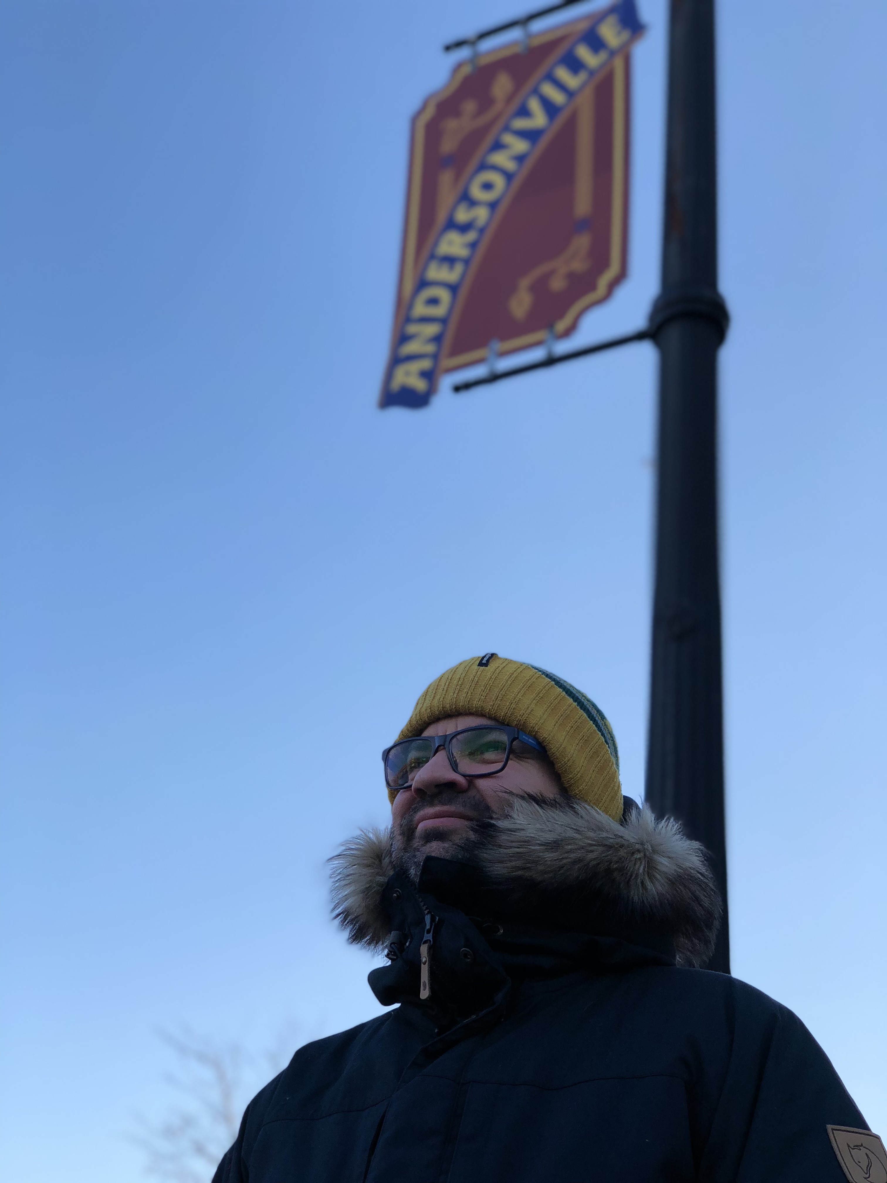 Mihkel Raud posing with an Andersonville street sign.