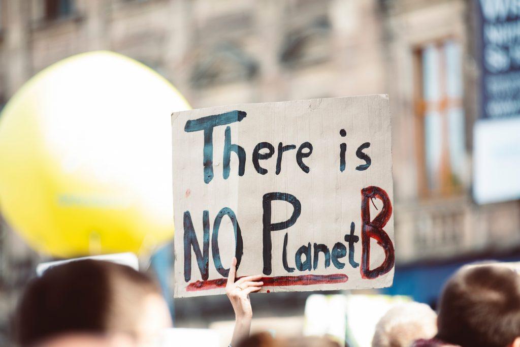 A climate change protestor's sign in Germany. Photo by Markus Spiske on Unsplash.