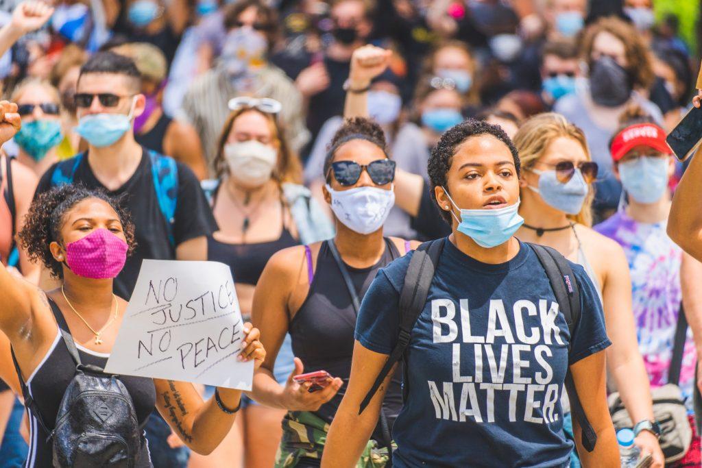 A Black Lives Matter protest in Cincinnati, OH. Photo by Julian Wan on Unsplash.