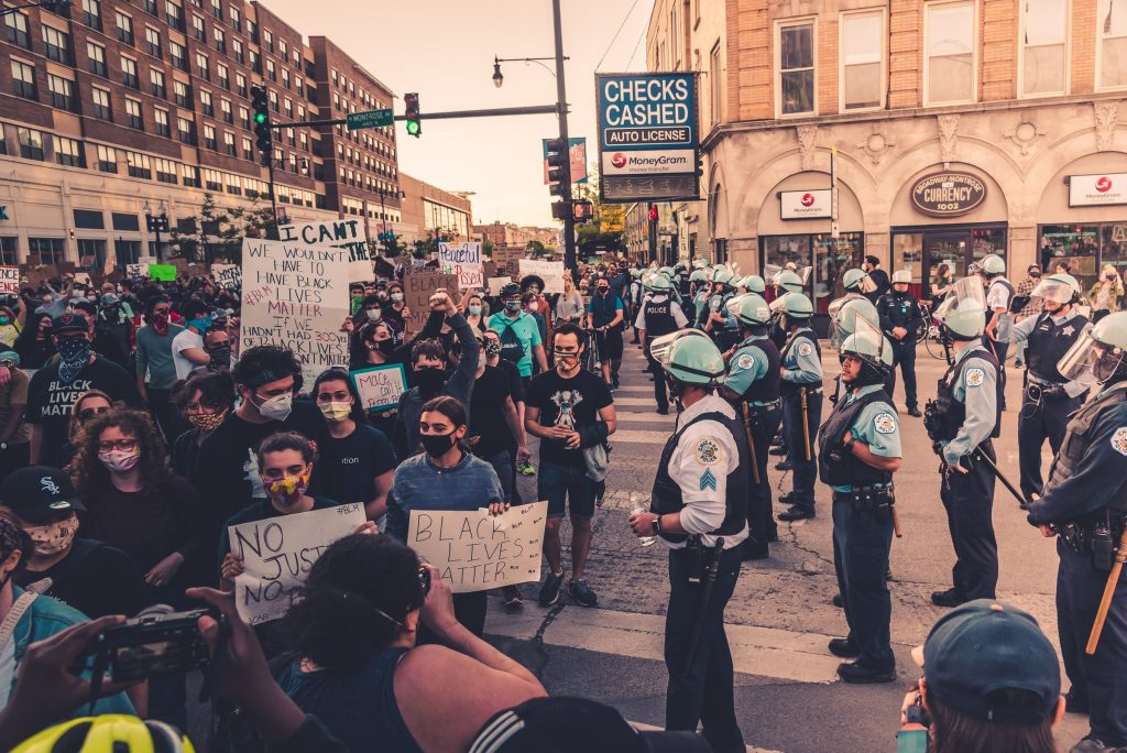 Chicago police officers keeping the peace at a Black Lives Matter demonstration. Photo by Max Bender on Unsplash.