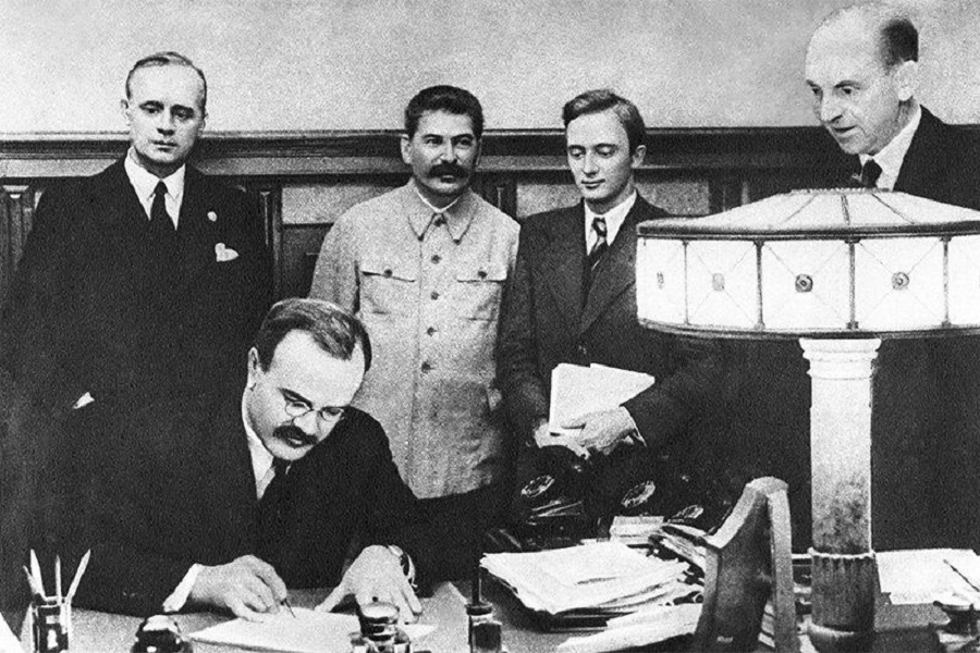 The signing of the Molotov-Ribbentrop Pact and its secret protocols in Moscow on 23 August 1939.