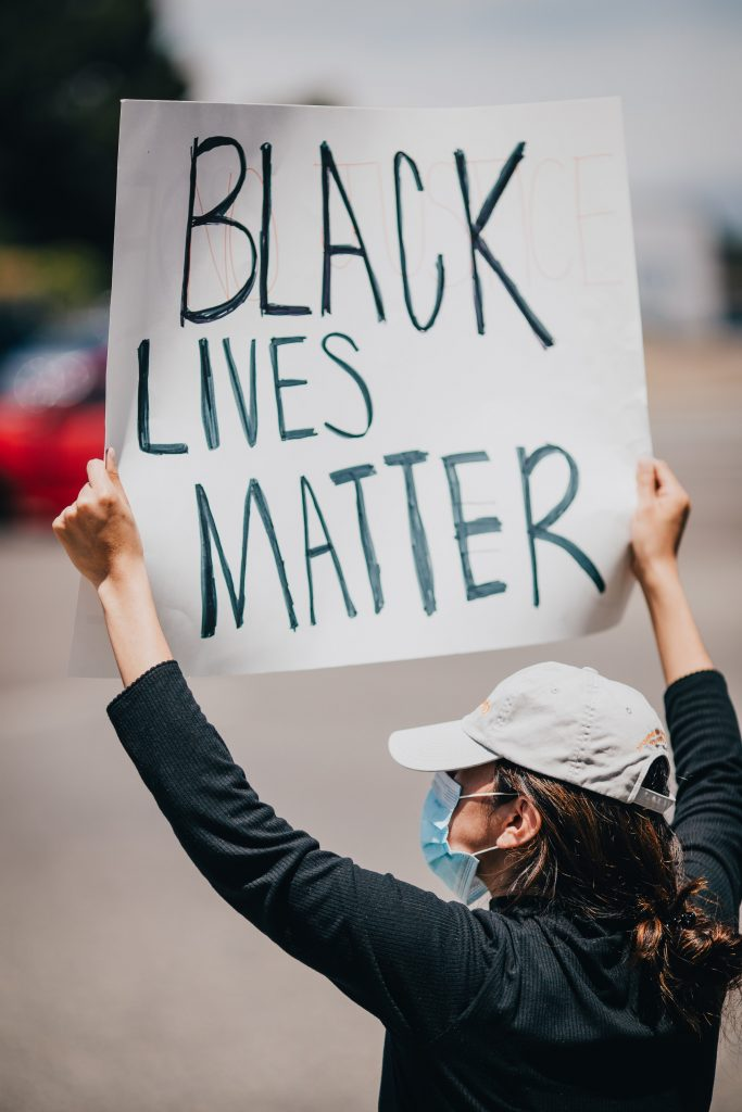 A demonstrator in Vista, CA. Photo by Vince Fleming on Unsplash.