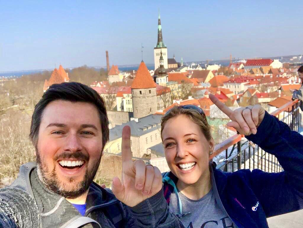 Craig and Kirsty Stenzel taking a selfie with the Tallinn Old Town in the background. Photo from the couple's Instagram.