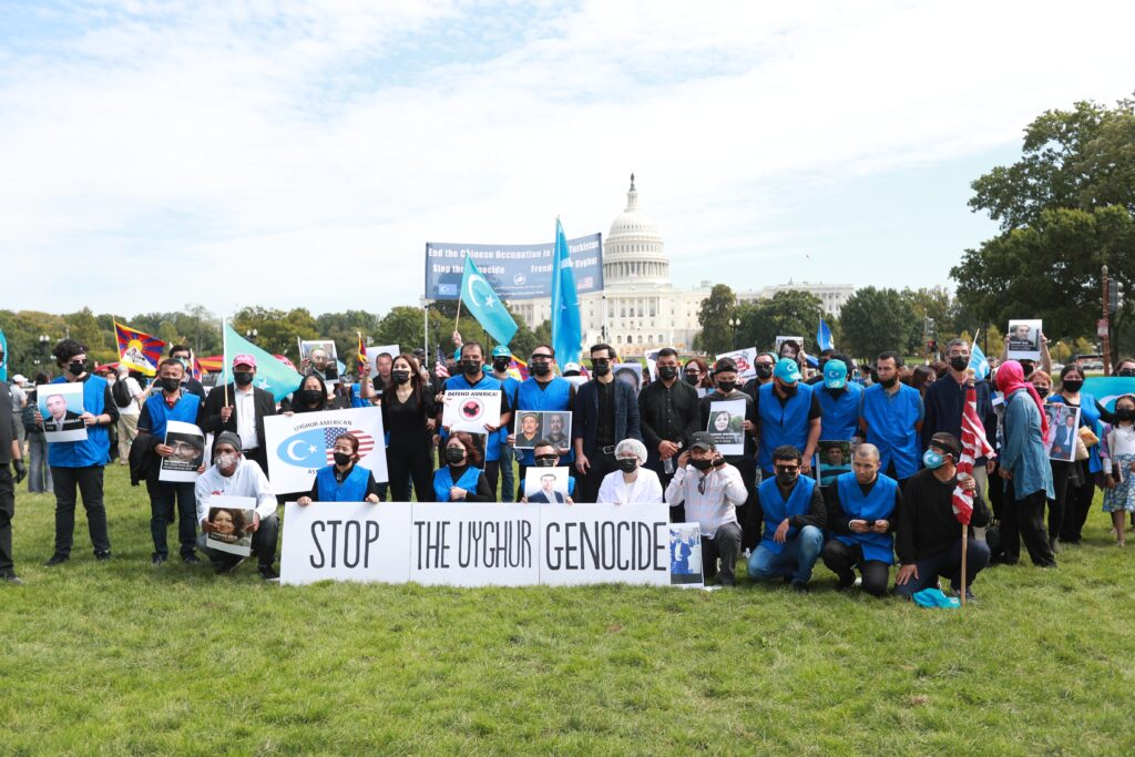 A demonstration in Washington, DC, against the Uyghur genocide in China. Photo by Kuzzat Altay on Unsplash.